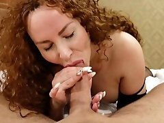Red-haired accomplished deep-throats a huge cock and blasts ferociously