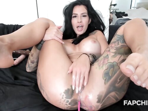 Busty Brunette With Amazing Tattoos Fingering Her Delicious Muff